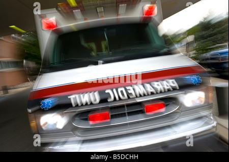 Ambulance Paramedic Unit Motion Blur Speeding Rushing To Accident Scene - Stock Photo