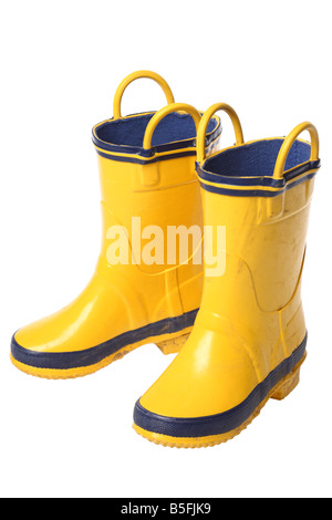 Yellow rubber boots cutout on white background - Stock Photo