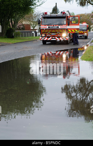 New Zealand fire engine with flooded road - Stock Photo
