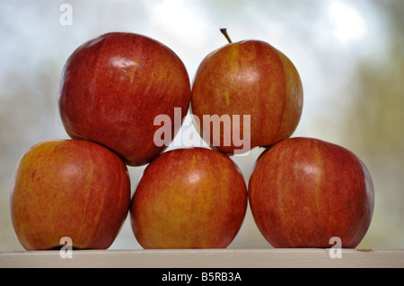 Apples stacked on a window sill - Stock Photo