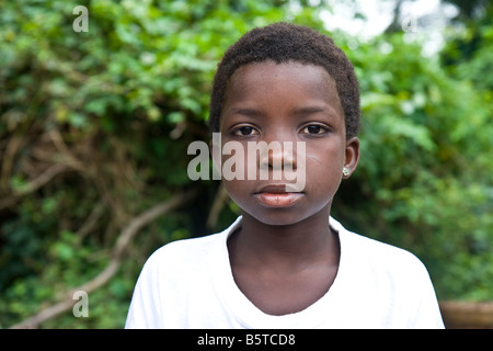 Portrait of an African girl whose education is being sponsored by a humanitarian aid organization. - Stock Photo