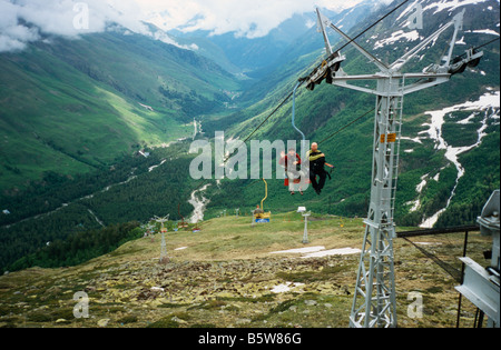 Mountain climbers in ski lift on Mt Cheget, Elbrus range, Northern Caucasus, Russia - Stock Photo