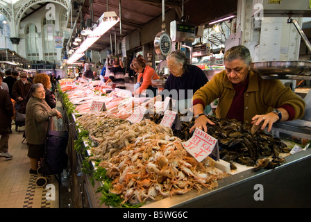 Seafood stall in the central fish market Mercado Central in the historical city centre of Valencia Spain - Stock Photo