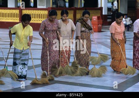 Burmese women ritual cleaning/sweeping at Shwedagon Paya, Burma's most sacred Buddhist site, Rangoon or Yangon, - Stock Photo