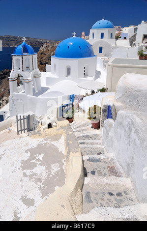 Stairs leading to a blue and white domed church and bell tower, Oia, Ia, Santorini, Cyclades, Greece, Europe - Stock Photo