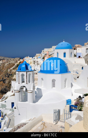 Blue and white domed church and bell tower, Oia, Ia, Santorini, Cyclades, Greece, Europe - Stock Photo