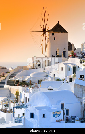 Windmill at sunset, Oia, Ia, Santorini, Cyclades, Greece, Europe - Stock Photo