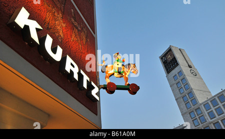 Shop sign of the KURTZ traditional games store in Stuttgart in Marktplatz Square with the town hall, Baden-Wuerttemberg - Stock Photo