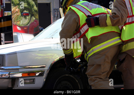 A jaws of life tool being used to do extrication on a vehicle - Stock Photo