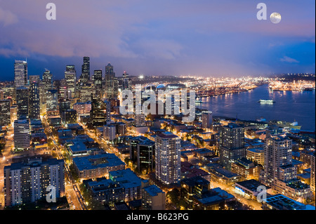 View over Elliott Bay and the city at night from the top of the Space Needle, Seattle, Washington, USA - Stock Photo