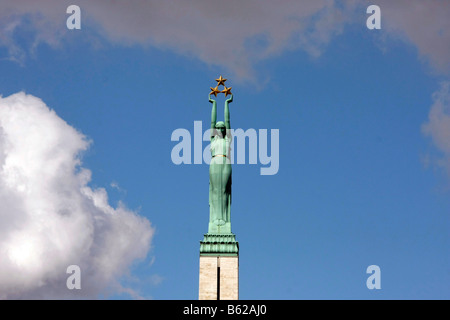 Allegory of Freedom statue on top of the Freedom Memorial in Riga, Latvia, Baltic states - Stock Photo