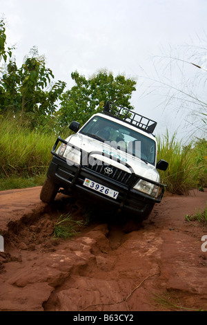 A humanitarian aid organization in Africa travels the dirt roads en route to a project visit. - Stock Photo