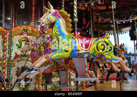 Brightly coloured horse on a Fairground Carousel - Stock Photo