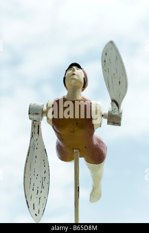 Wooden whirligig carved in the shape of swimmer - Stock Photo