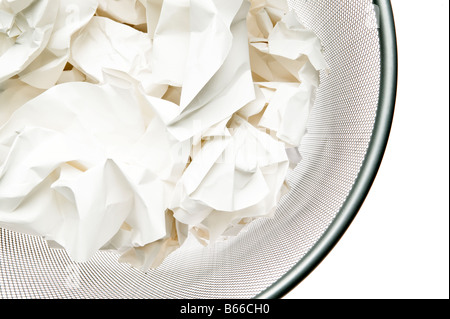 grey metal waste paper basket filled with crumpled white paper - Stock Photo