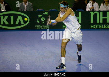 Argentinian tennis player Juan Martin Del Potro hitting a backhand shot during the 2008 Davis Cup final against - Stock Photo
