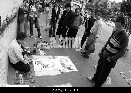 The Chinese lower class struggle for work daily As global economic crises widens as unemployment increases,and income - Stock Photo