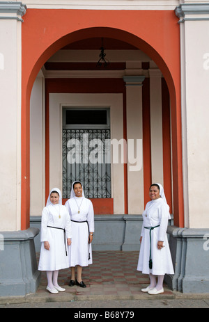 Colonial building and architecture and nicaraguan nuns Granada Nicaragua - Stock Photo