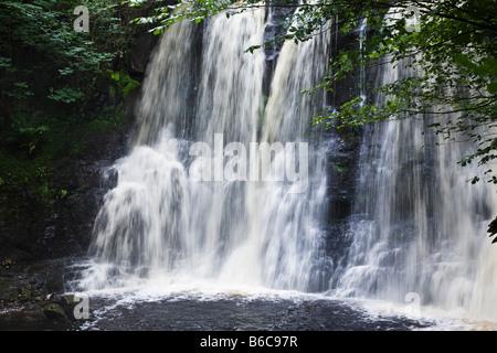 Ess na Crub waterfall on the Inver River, Glenariff Forest Park, Glens of Antrim, County Antrim, Northern Ireland - Stock Photo