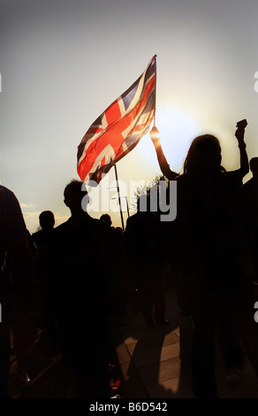 Glasgow Rangers Football Fans arrive at the City of Manchester Stadium with Union Jack flag - Stock Photo