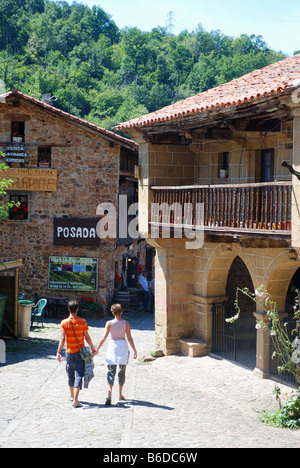 Young couple walking in the street. Barcena Mayor. Cantabria province. Spain. - Stock Photo