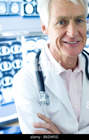 Radiologist beside CT scans. CT scanning is a diagnostic technique that uses X-rays to produce cross images. - Stock Photo