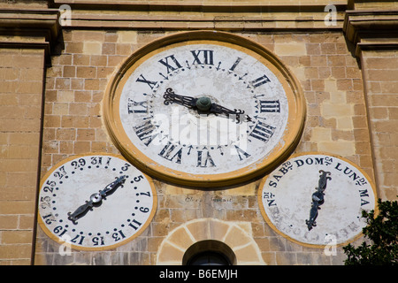 Clocks on the clock tower, Saint John's Catholic Cathedral, Saint John's Square, Valletta, Malta - Stock Photo