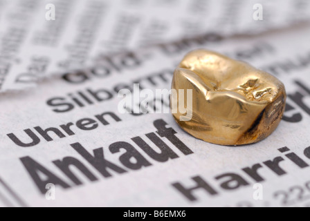Dental gold on a newspaper advertisement, sale of dental gold - Stock Photo
