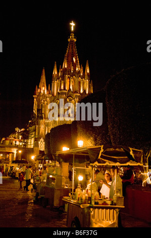 Street Corn Vendors on Friday Night, the Jardin Square and Parroquia Church, San Miguel de Allende, MEXICO - Stock Photo