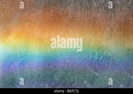 Rainbow with droplets at a waterfall in Iceland, Europe - Stock Photo