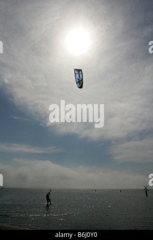 Kite flying on a beach in southern France. - Stock Photo