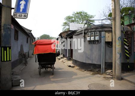 Rickshaw running on hutong - Stock Photo