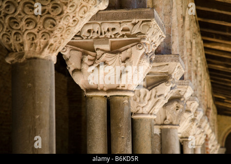 Close-up of the columns in the cloisters of the Saint-Pierre abbey in Moissac, France. - Stock Photo