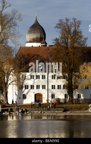 Church tower with clock, bell tower, the Benedictine monastery Frauenwoerth, Fraueninsel island, Lake Frauenchiemsee - Stock Photo
