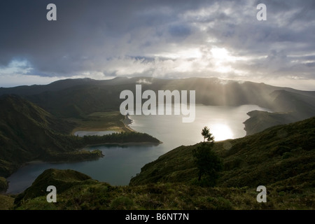 Aerial view of Fire Lake or Lagoa Do Fogo on the Portuguese Island of Sao Miguel in the Azores with strong sun beams - Stock Photo