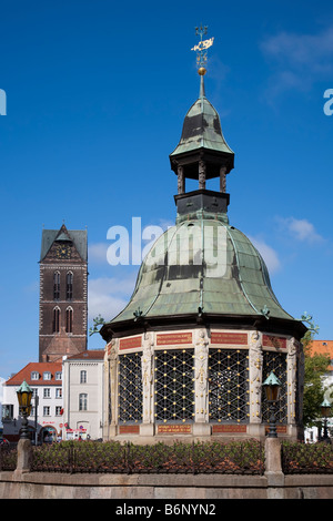 Wasserkunst waterworks 12 sided well to supply drinking water from a well in the market place Wismar Germany - Stock Photo