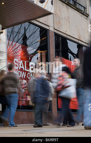 Shoppers in Princes Street for the sales on Boxing Day - Stock Photo