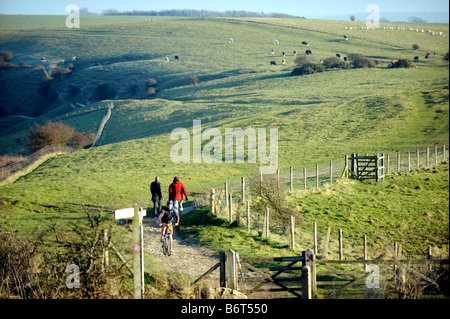 Cycling and walking on the South Downs at Ditchling Beacon in Sussex UK - Stock Photo