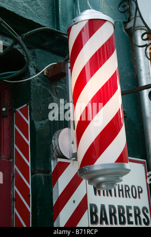 Traditional Barber Shop Red & White Pole in Cork, Ireland - Stock Photo