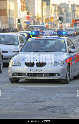 Police car with flashing blue lights in traffic Holloway Road Holloway Islington London England UK - Stock Photo