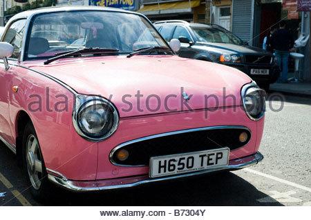 Pink Nissan Figaro - Stock Photo