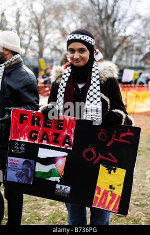 A young woman holds a sign in preparation of the march - Stock Photo