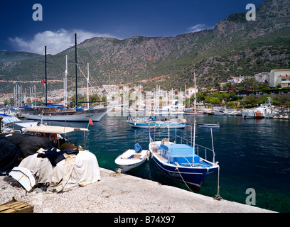Fishing dayboat and gulet in Kas Town Harbour,turkey - Stock Photo