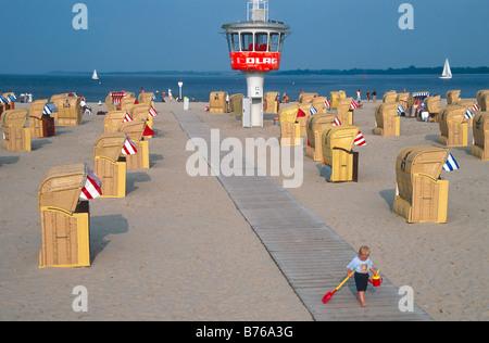 beach chair sandy beach travemuende schleswig holstein germany luebeck bay baltic sea seaside - Stock Photo