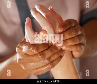 Hand massage, Ayurveda, spa, Oberoi Luxury Hotel, Mauritius, Indian Ocean - Stock Photo
