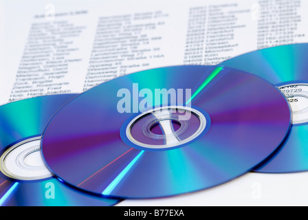 Cds on an address list, symbolic picture for data trade, stealing data - Stock Photo