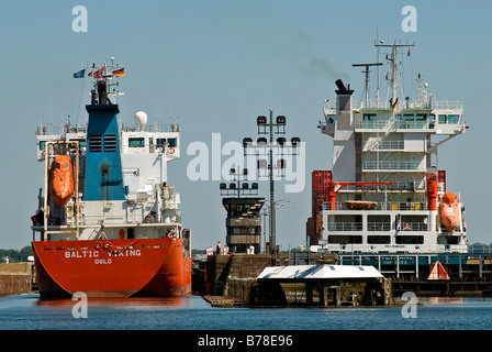 Close-up of container ships chanelling into the Holtenau floodgate, Kiel, Schleswig-Holstein, Germany, Europe - Stock Photo
