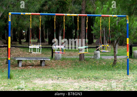 children's' swings in a playground,Uruguay  -  ©Marty Heitner - Stock Photo