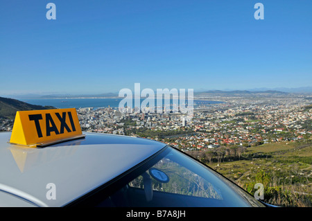 View over over a taxi roof onto Cape Town from the Table Mountain cable car base station, South Africa - Stock Photo