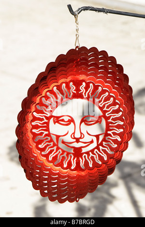 This sun chime is displayed being hung while the wind spins it Photo taken in Venice California 14DEC08 - Stock Photo
